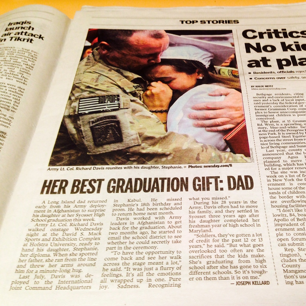 My story (and photo) for Newsday about an Army dad who reunited with his unsuspecting daughter at her high school graduation ceremony.