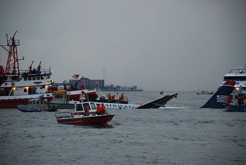 US Airways Flight 1549 crashed into the Hudson River on Jan. 15, 2009, and joint rescue efforts by the Coast Guard, NYPD and nearby ferries and boats ensured that all passengers on the plane were taken to safety. (Photo by Chris Gardner, USACE New York District Public Affairs/Wikicommons)