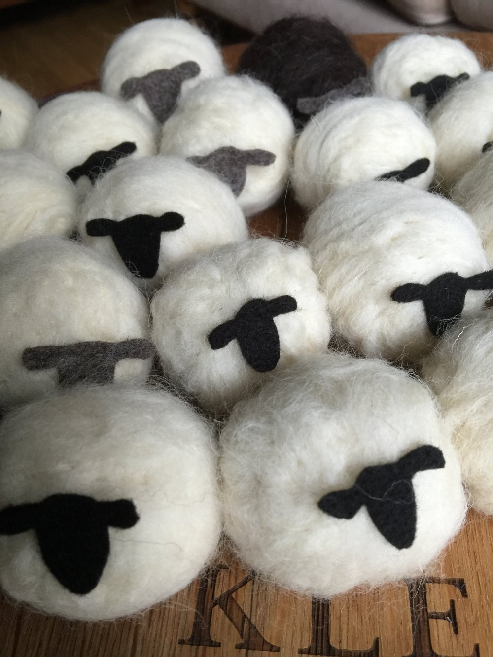 Needle felted hanging sheep.  Imagine a flock of sheep on your Christmas tree!  Use them all year round as decorations around your home