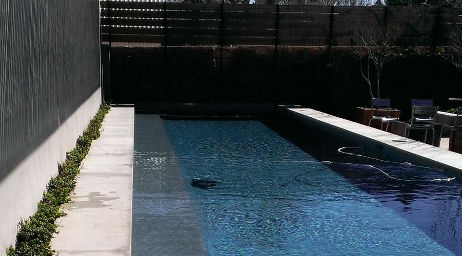 Courtyard garden, koi pond and pool in Marfa TX
