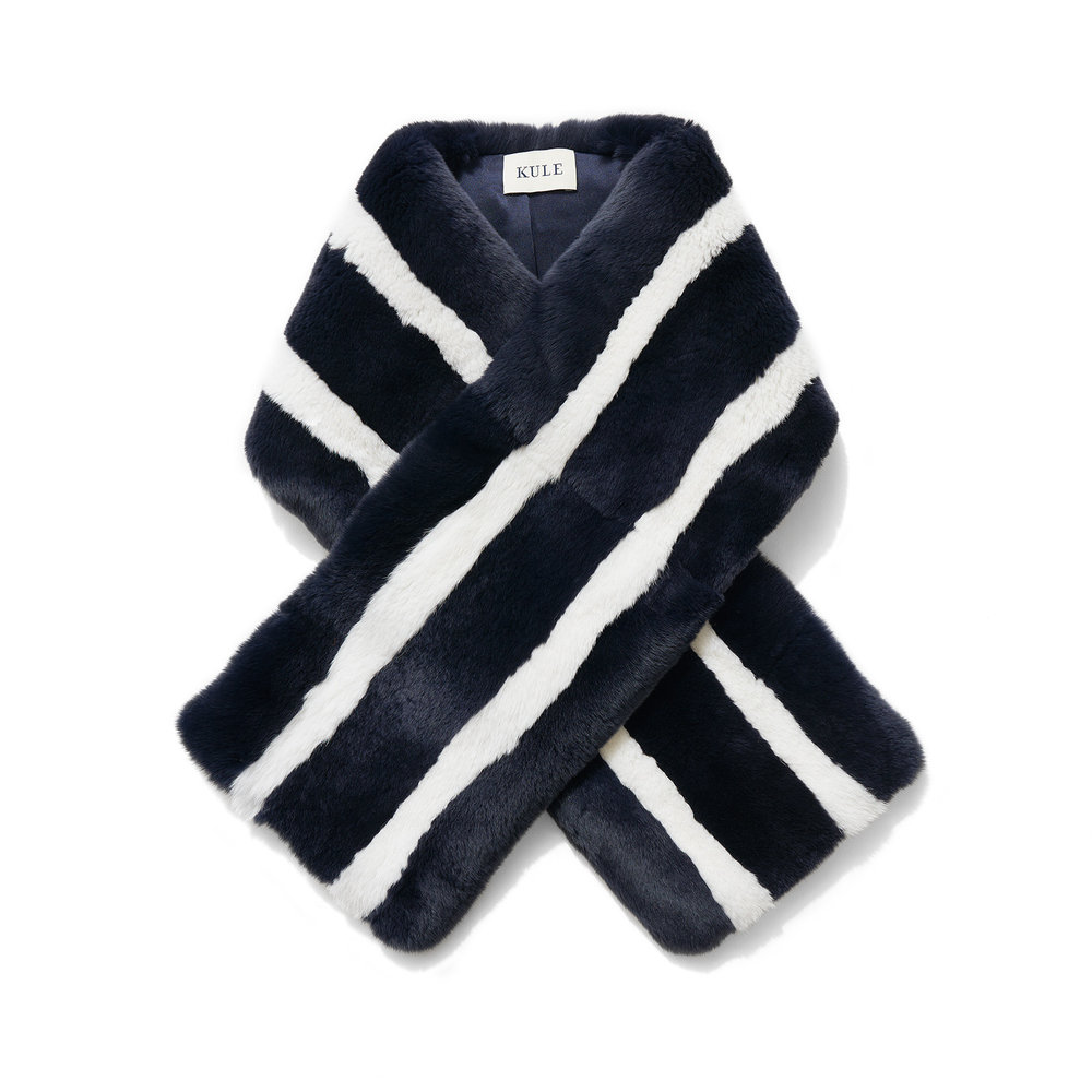 Kule - Monroe - Navy/White $650.00 Versatile, Kule's scarf will keep you warm and can be worn in so many different ways. Crossed for a menswear-inspired look; loose or wrapped around the neck for a subtle striped pop. Kule is driven by a love of iconic fashion brands and the modern preppy aesthetic.