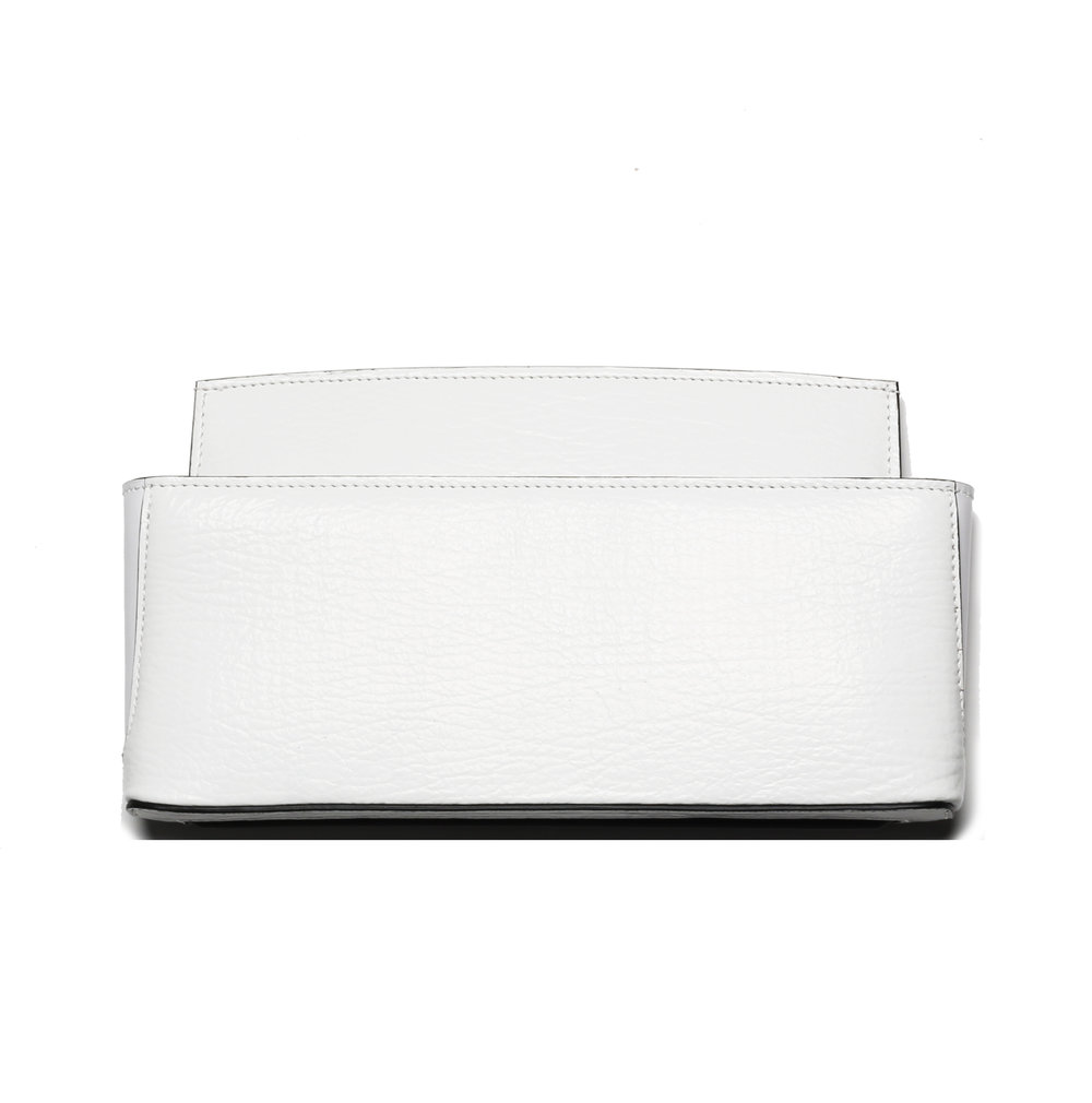 MCC0LLM - Leather + Shark White Clutch  $950.00   MCC0LLM's Italian craftsmen have held a strong commitment to fulfilling today's handbag desires with their collection of supremely constructed and highly functional leather goods.