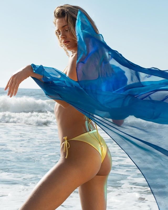 Feel the sublime energy of the ocean. The Triangle Bikini in Metallic Yellow is available now in stores and via the link in our bio. #SaraCristina