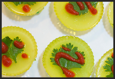 Pineapple Lime Coconut Sriracha Shotchas :  Layers of Lime and Pineapple gelatin, flavored with coconut rum and topped with sriracha.  The ultimate in sweet and spicy. 1oz