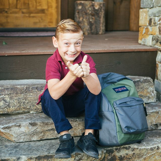 "1st day of Kindergarten for my little man today.  Last night was rough. His heart was sad, but we worked through it.  I thanked the Lord all day that he woke up with a happy heart, ready to face this big day with courage and bravery. And that's exactly how he walked straight into his new classroom. He actually wanted to walk to school by himself [HA!]....not yet, little man. Soon!  I know without a doubt that the hand of God is all over Ezra. I've sensed it since he was little.....his heart is tender, he's very attentive to people and his surroundings...and the questions he asks always has me growing in my own faith. He's a gift. I love being his mama.  Seems like yesterday I was holding him in the hospital and blogging about the phrase ""the days are long, but the years are short."" Didn't realize how quickly Kindergarten would come.  Love you, Ezra. Don't ever forget.....You're The Head, Not The Tail."