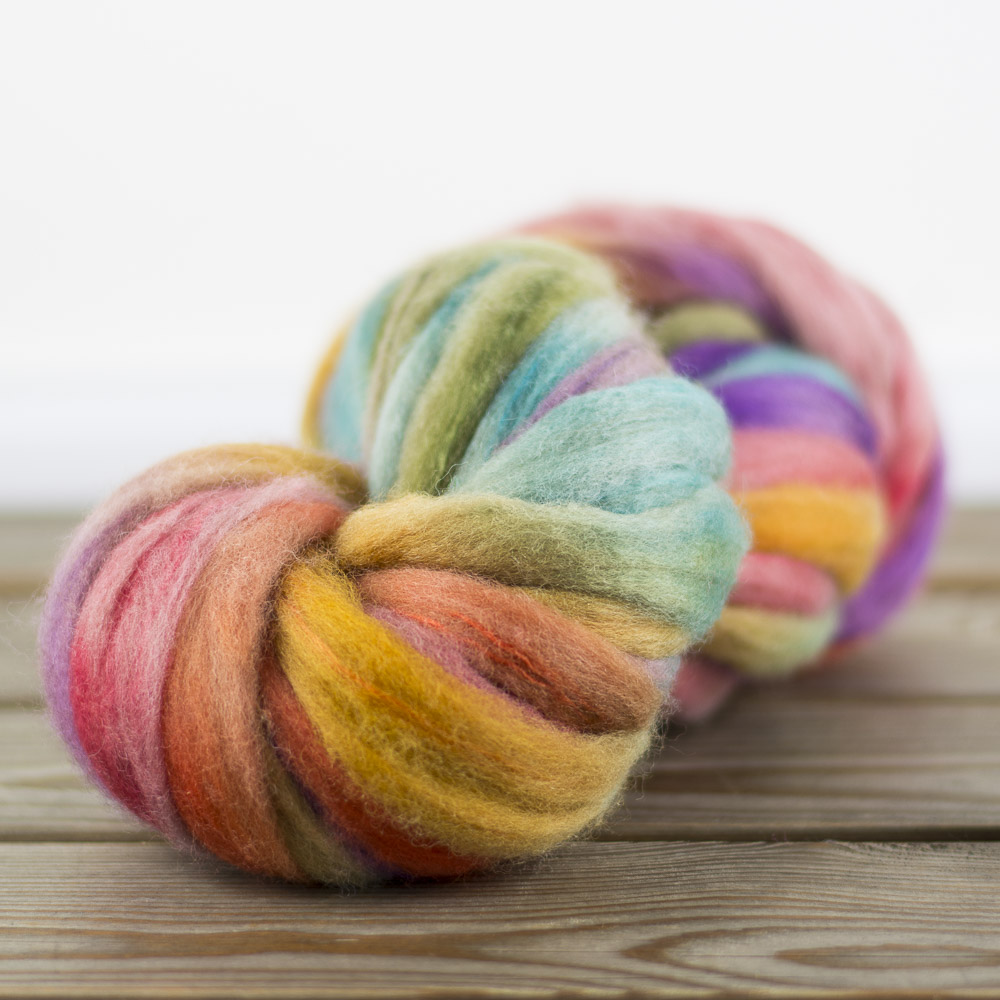 Bond Pencil Roving (with a little silk) in Ignite is hand-painted here at Sheepspot.