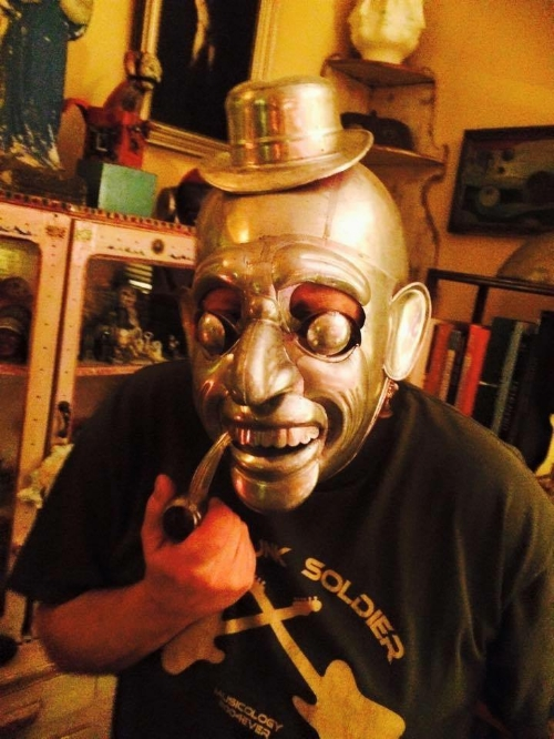 Here's Tabor now! That's not his real face...he's wearing a Bolivian mask made from tin.