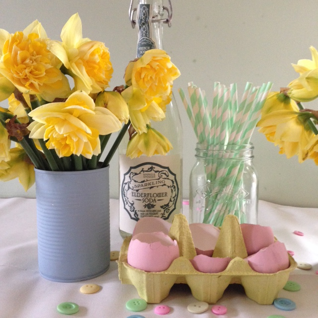A bit of Easter decoration - iconic spring flowers in a painted tin, painted egg-shells in an egg box, pretty pastel buttons scatter around and sparkling elderflower soda, bringing a hint of the summer to come. {the paints are Farrow & Ball 'Lulworth Blue' and 'Nancy's Blushes'}