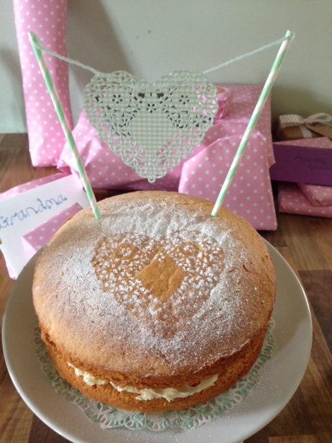 I made this cake bunting in under five minutes. I just threaded a pretty doily (again from John Lewis) onto some of the green wool leftover from making the pom-poms and cut two slits in the top of each stripy straw, squeezed the wool through and snipped the loose ends. Ta-dah!