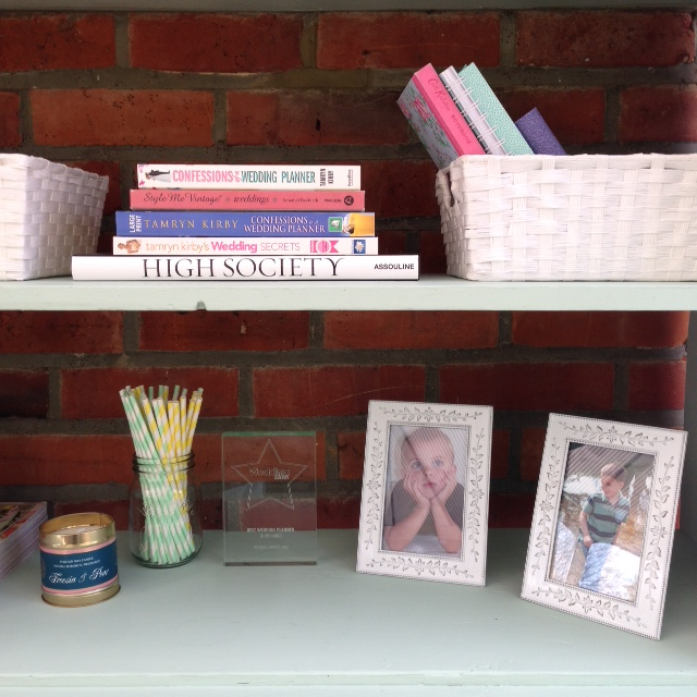 A few of my favourite things - pictures of my son when he was younger, one of my awards from my days as a wedding planner, a scented candle, a couple of copies of my books and also  'Style Me Vintage: Weddings'  by the lovely Annabel of  Love My Dress