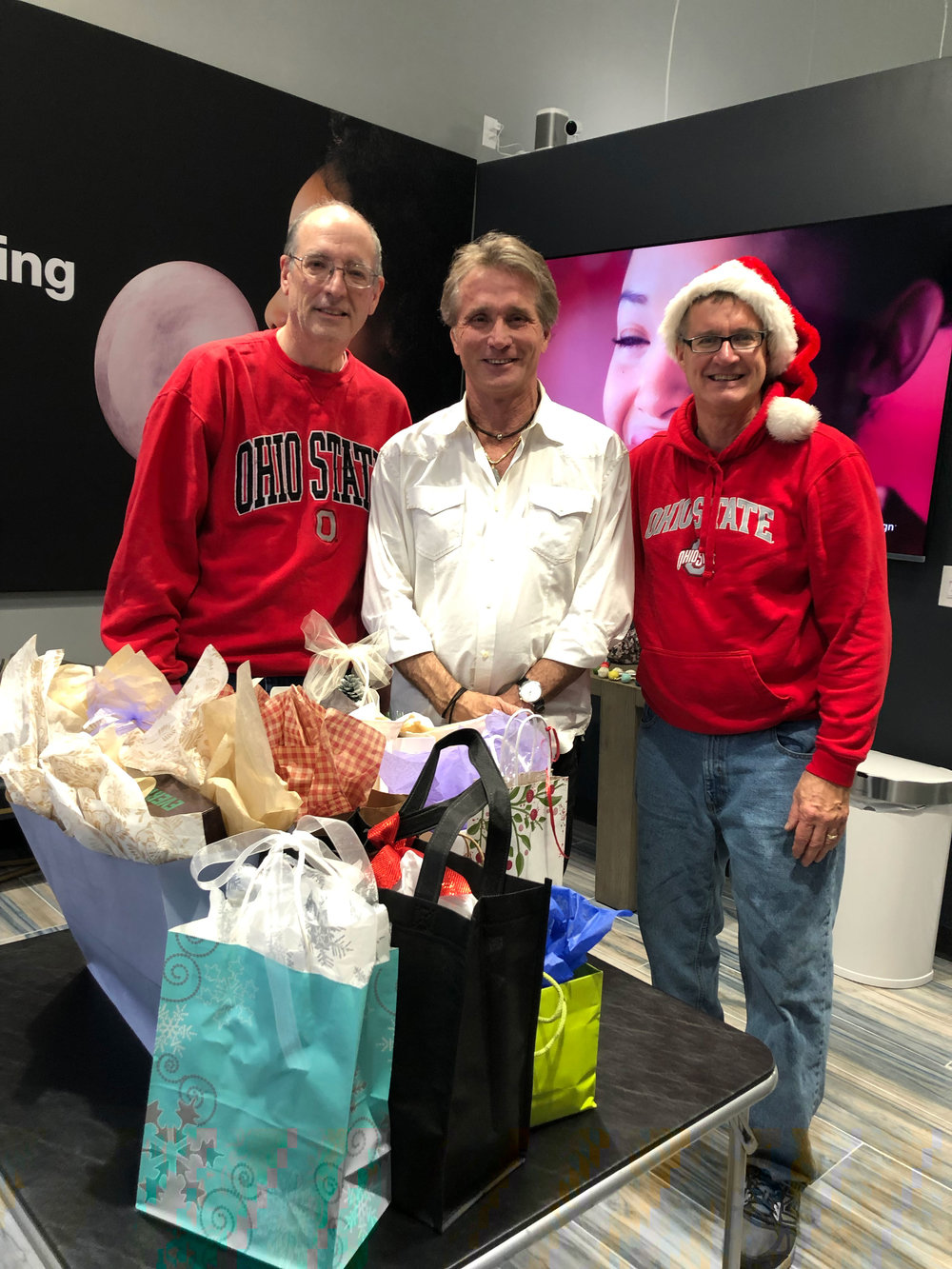 Prize winner Mike Gallagher, Dr. John White, DDS, MSD and Bill Brink of Beachcliff Market Square shared the holiday spirit!