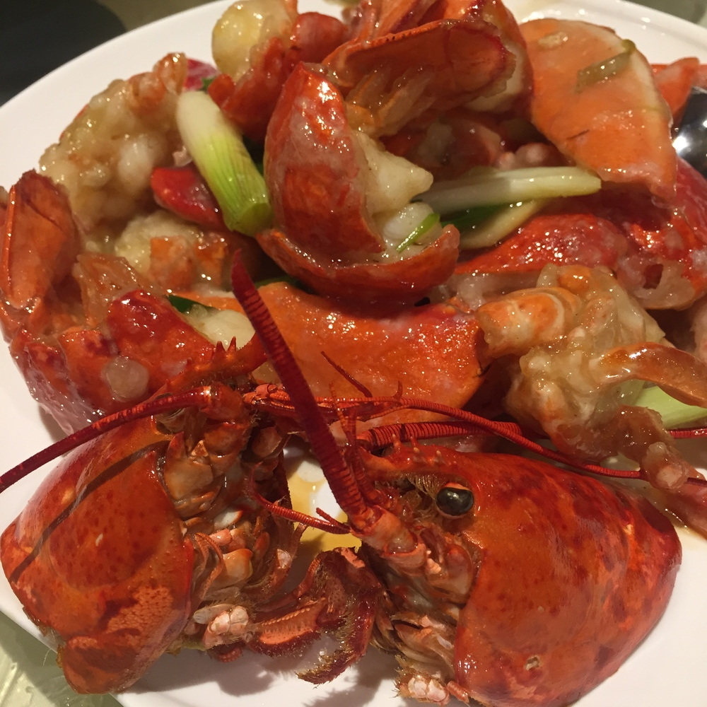 Twin lobsters with ginger and scallions
