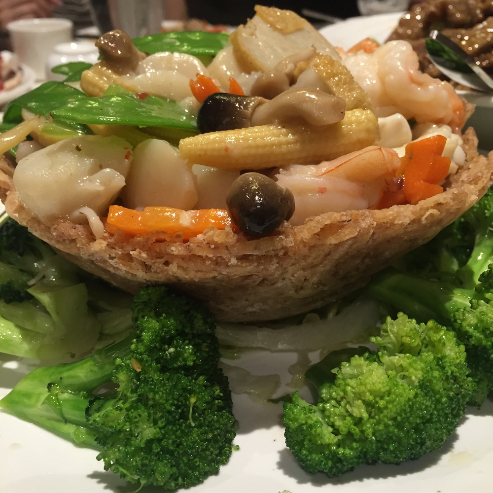 Seafood combination in bird nest