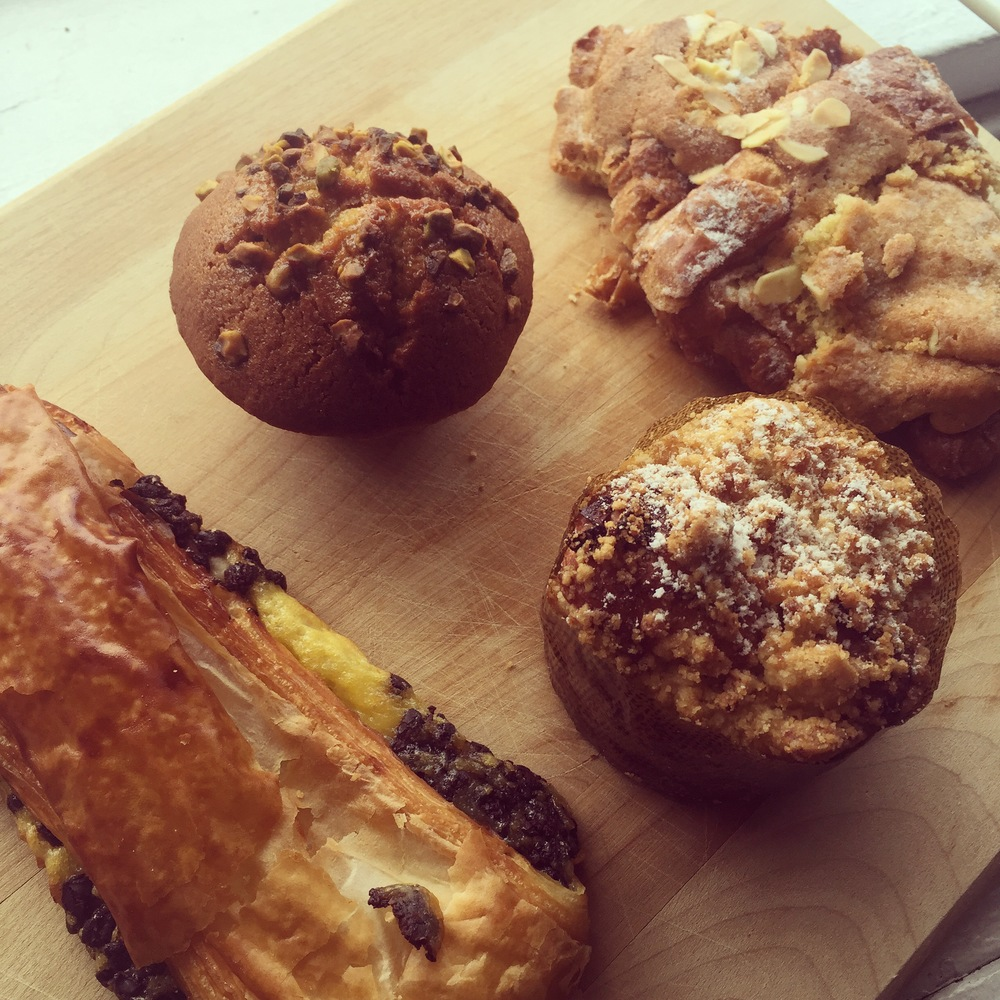 Clockwise from left: pain au chocolat, pistachio financier, almond croissant, apple brioche
