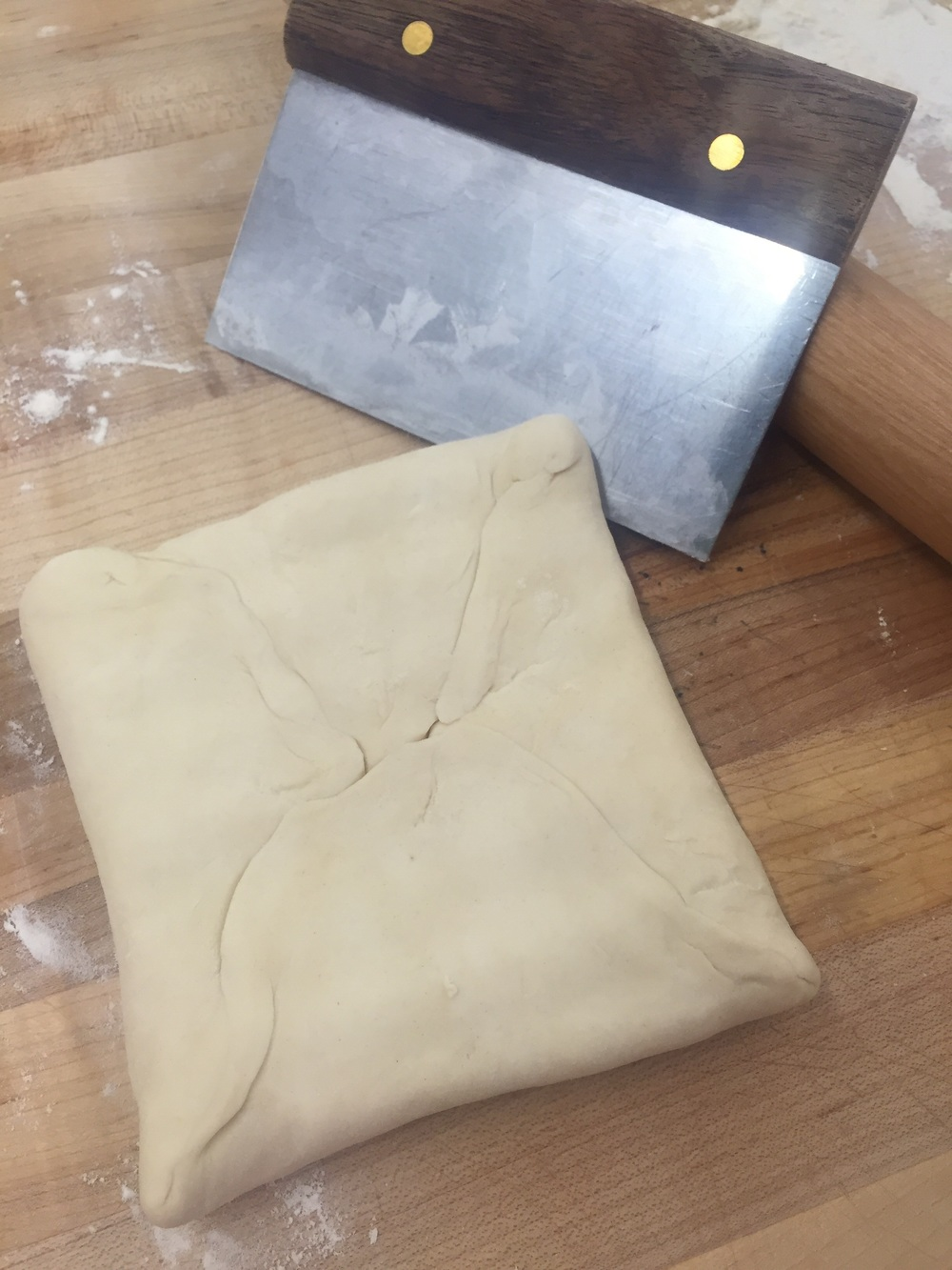A perfect puff pastry dough package - no butter peeking out anywhere!