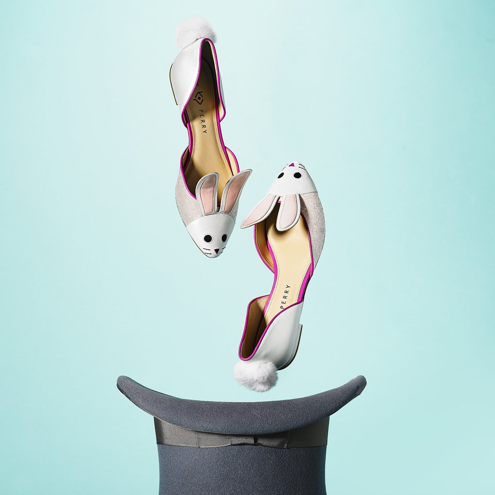 Photograph for Macy's Social Media. Styling by Rebecca Crea.  Katy Perry bunny shoes magically coming out of a magician hat.