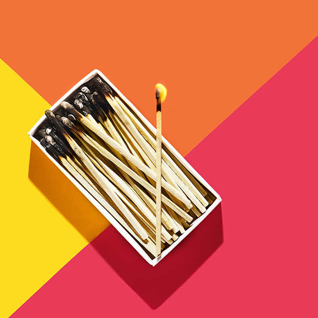 Styling by Genna Moss. Art Direction by Sharar Behzad.   Conceptual still life photograph of burned matches in a rectangular box.