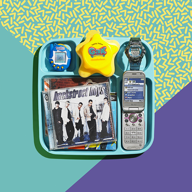 Styling by Sharar Behzad.   Conceptual still life photograph of a backstreets boys cd, gal, baby g watch, tomagatchi, and cell phone from the 1990s shot in an NYC studio.