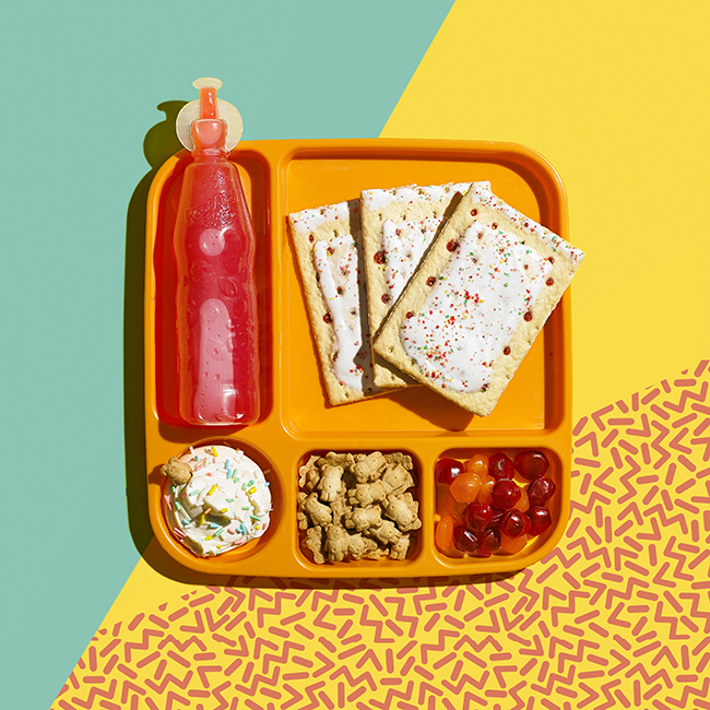 Styling by Sharar Behzad.   Conceptual still life photograph of foods from the 90s featuring dunkaroos, pop tarts, and gushers.