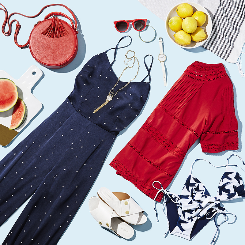 Still life image of woman's summer clothing with lemons and watermelon