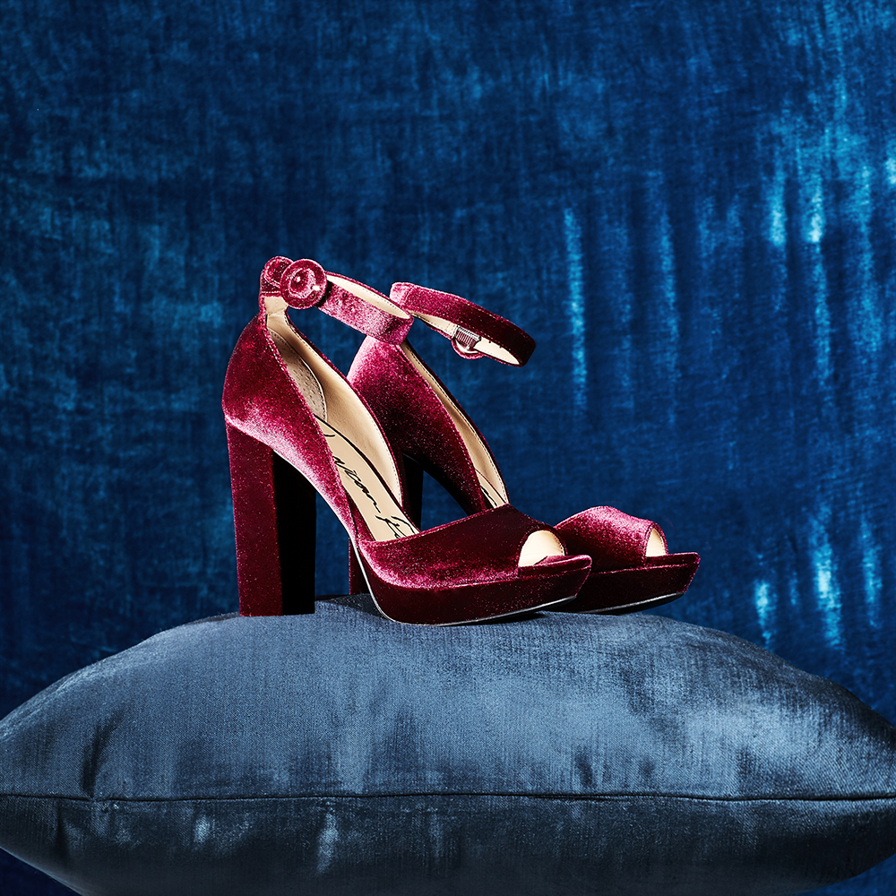 Photograph for Macy's Social Media. Styling by Rebecca Crea.  Conceptual still life photograph of a dark red shoes on a blue pillow.