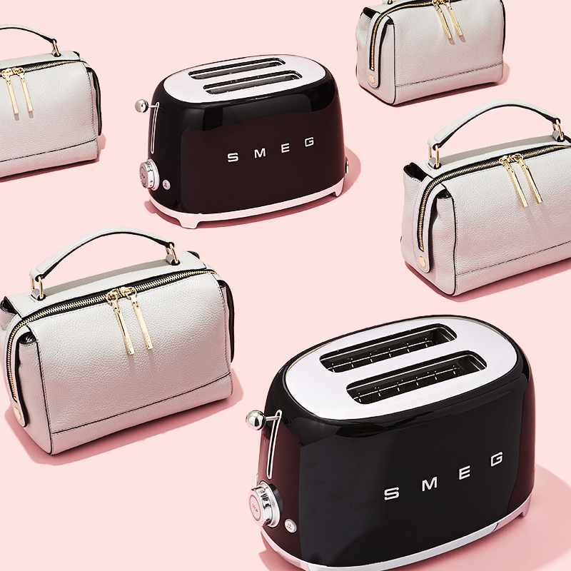 Shot for Amazon. Styling by Anna Lemi. Conceptual still life photograph of gray bucket handbags and SMEG toast ovens on a bright pink background.