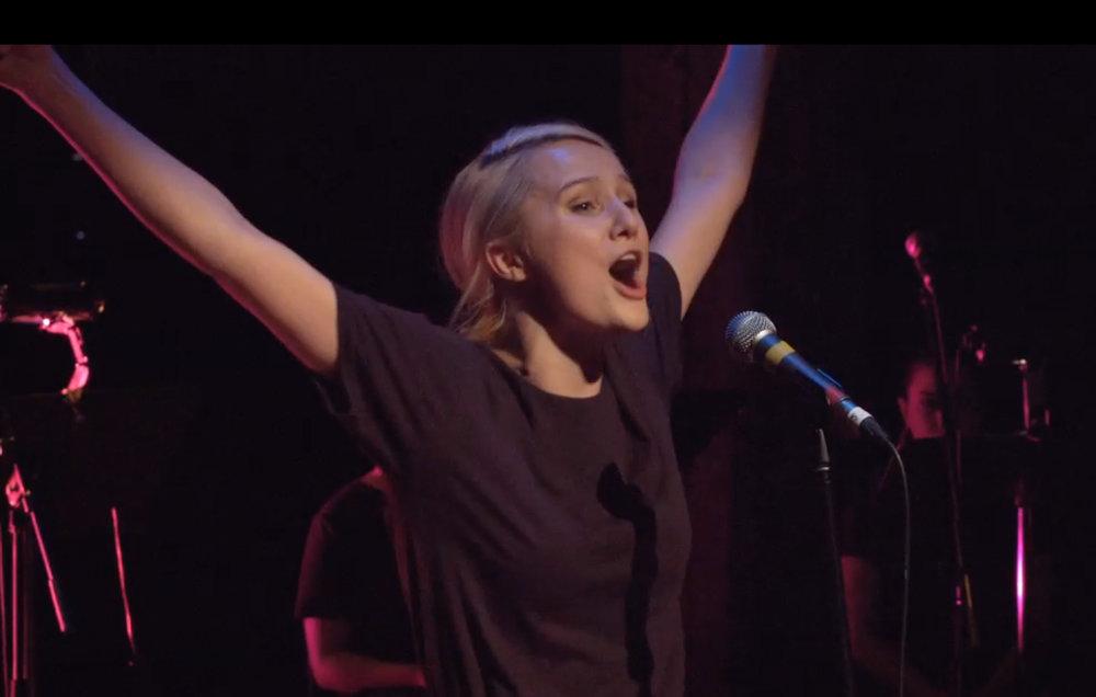 Yve Arms up singing crop.jpg