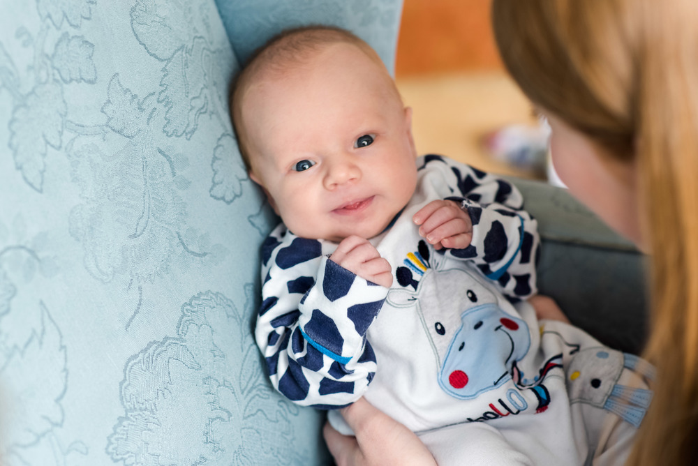 05 - Newborn in a girraffe onsie in a blue chair.jpg