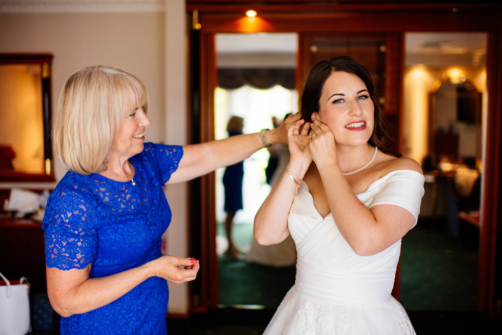 12 Lillibrooke Manor Berkshire Mother Helping Bride Wedding Photography.jpg
