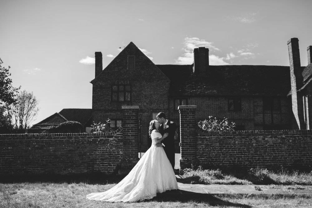 23 Lillibrooke Manor Berkshire Bride Groom Kiss  Wedding Photography.jpg