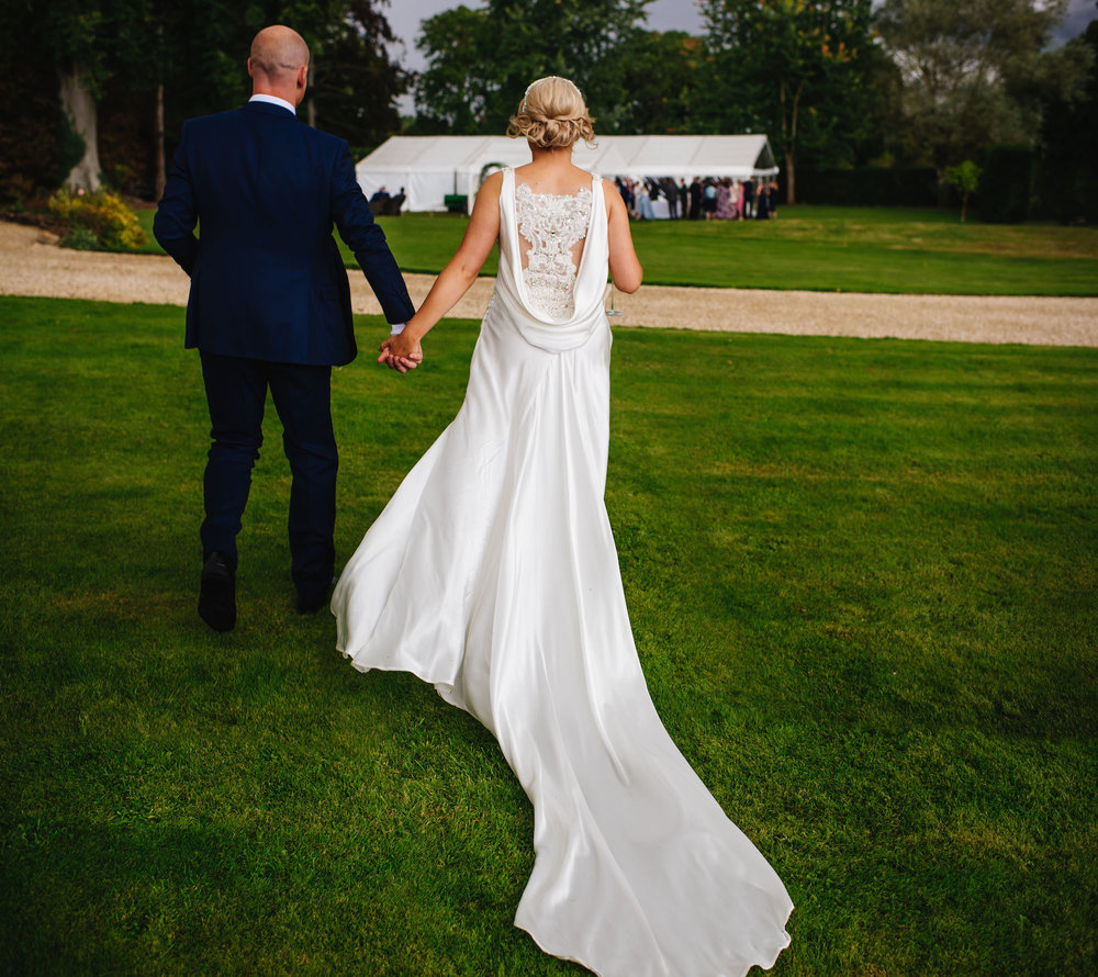 09_Rushall_manor_wiltshire_wedding_photography_bride_groom_backless_silk_dress.jpg
