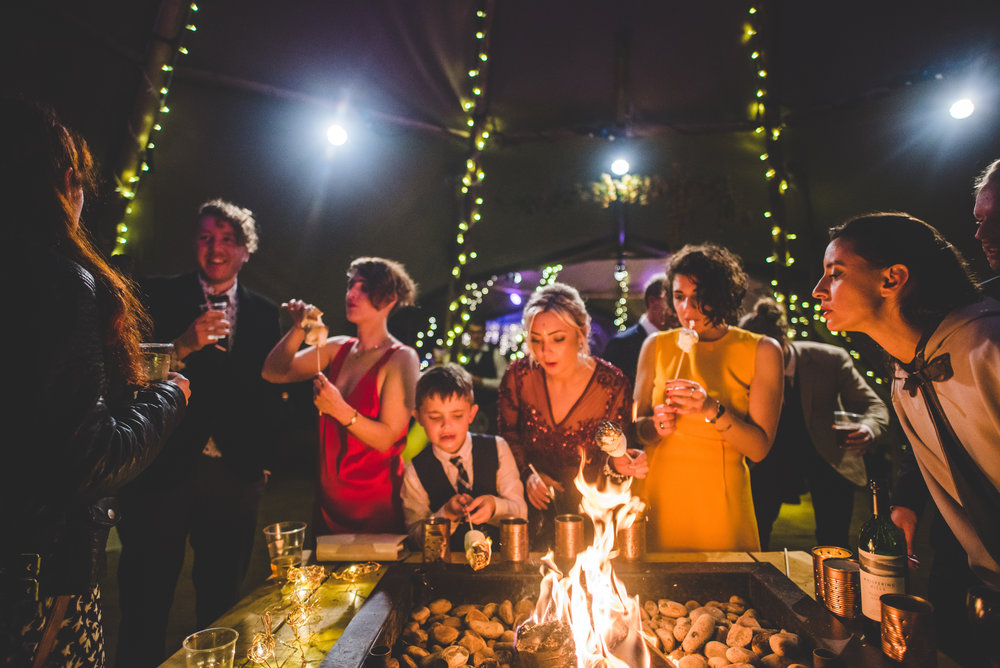 17 Tackeroo Caravan Site Woodland Weddings Staffordshire St John's House Guests Enjoying Fire and Marshmellows.jpg