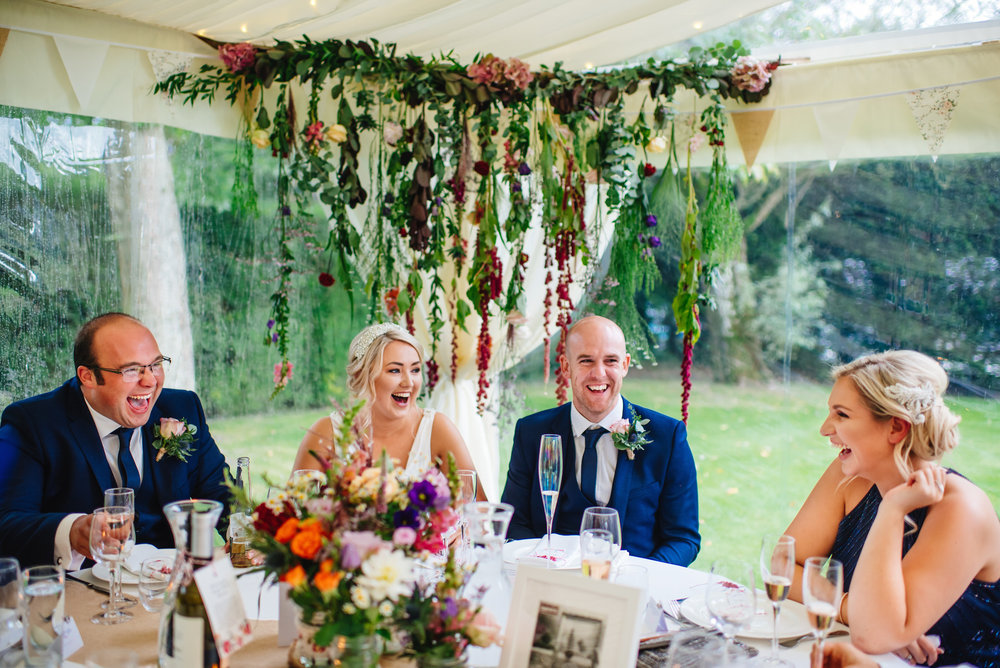 17_Rushall_manor_wiltshire_wedding_photography_bride_groom_laugh.jpg