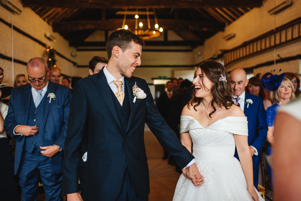 26 Lillibrooke Manor Berkshire Wedding Photography Bride Groom Aisle First Look.jpg