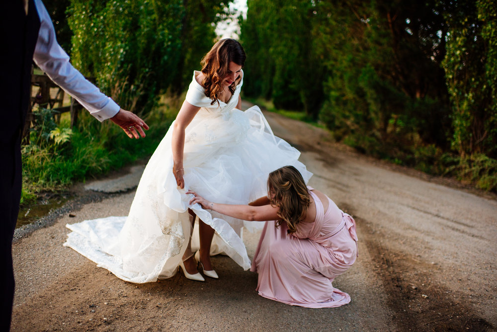 18 Lillibrooke Manor Berkshire Wedding Photography Bride Bridemsmaid Helping Hand.jpg