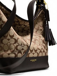 Signature Fabric was introduced during the mid-90's revamping of Coach. www.coach.com