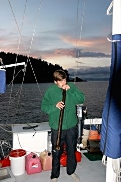 Miles plays an Alaskan bull kelp version of an Australian instrument, the didgeridoo.