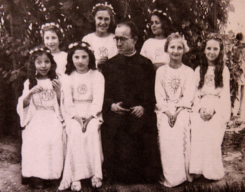 Communion, 3 June 1943, The Convent of Sisters of Immaculate Conception Wasaw. Judy's sister Tosia is sitting to the left of the priest. She is not the only Jewish girl in this group. In fact, 4 out of the 7 girls are Jewish!