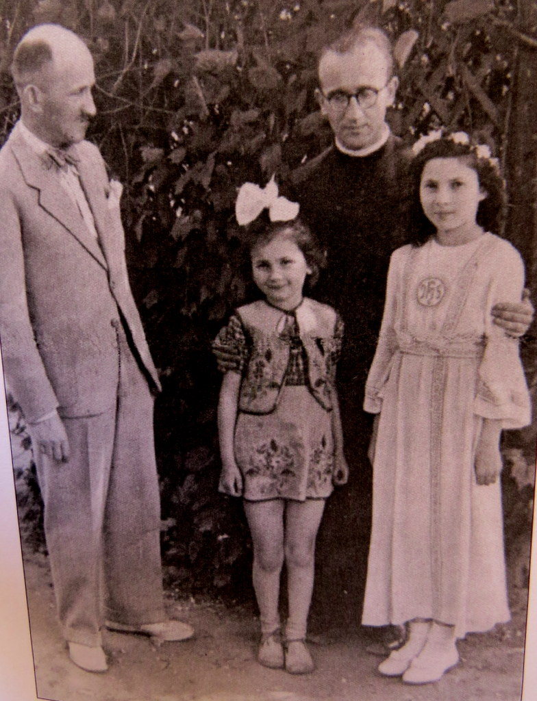 Judy's father Stefan, with his daughters and Father Ussas, on the last day they were together in June 1943.