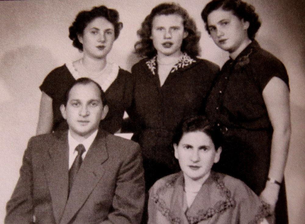 Family portrait taken in Europe before the trip to Australia: Judy's mother Fela and her brother Natan, seated; Tosia, Natan's wife Uschi and Judy, standing.