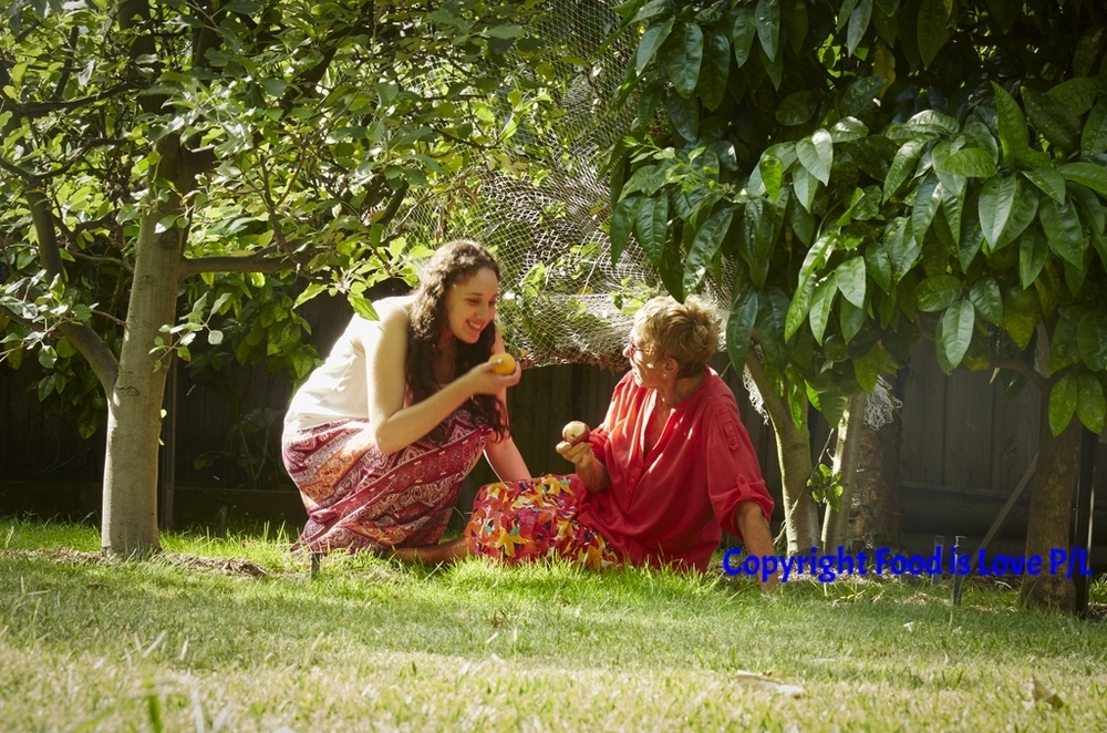 Judy Kolt in her garden with her grand-daughter Aviva Green