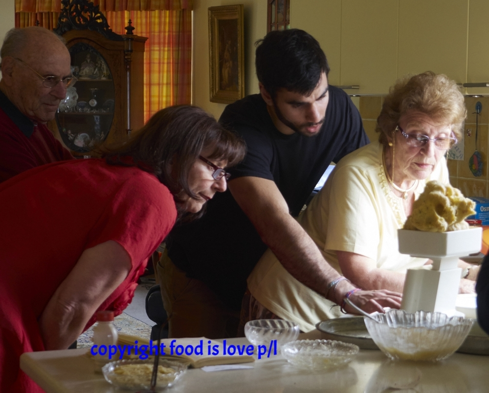 Renee Gompes cooking with her family including daughter Linny, husband Michel and grandson Daniel.
