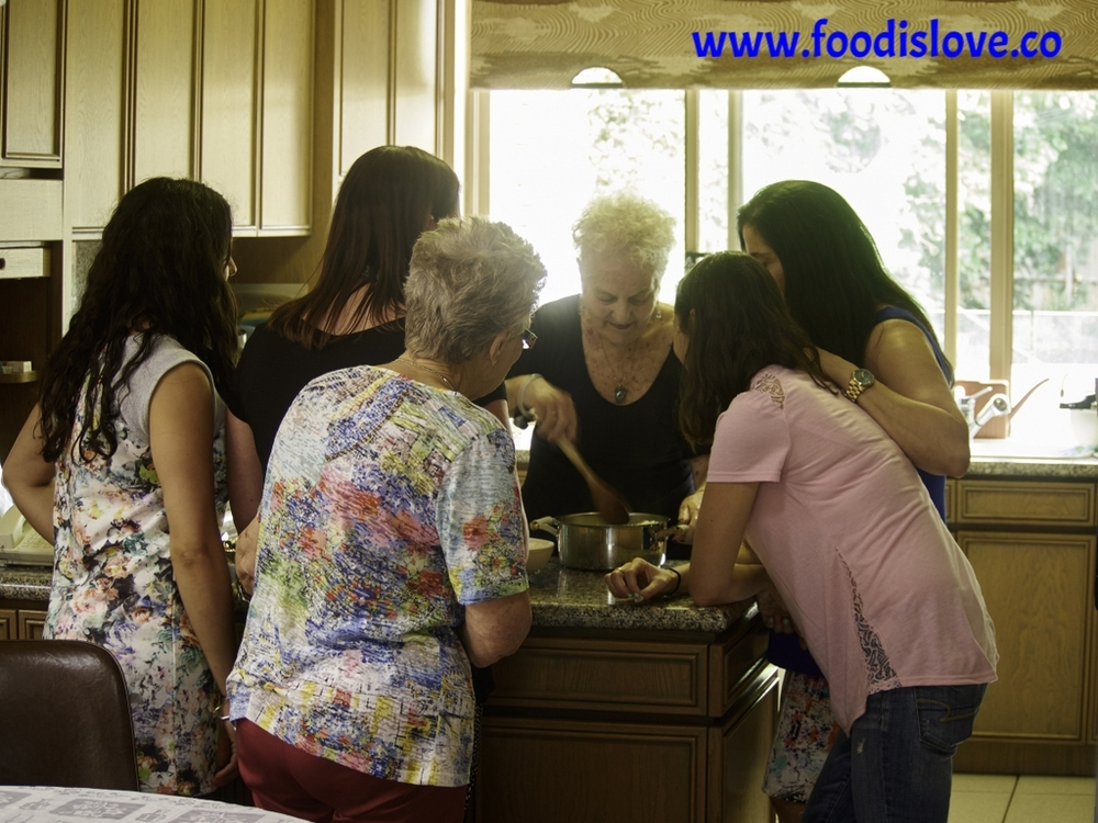 Viviane Levy, surrounded by daughters-in-law and cousins as she explains the secrets of her Yellow Soup