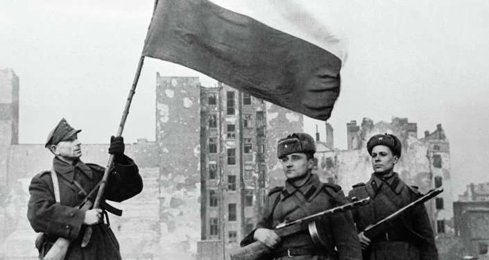A Polish soldier   raises the flag after Russian soldiers enter Warsaw. There is criticism of the Red Army for sitting outside Warsaw for 2 months rather than entering the city and preventing widespread destruction and bloodshed. However Genia and her girls wept with joy when the Russian soldiers arrived.