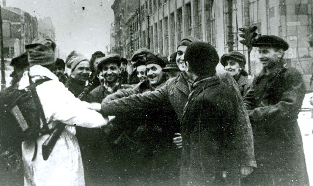 Warsaw residents greet a Russian soldier, January 1945