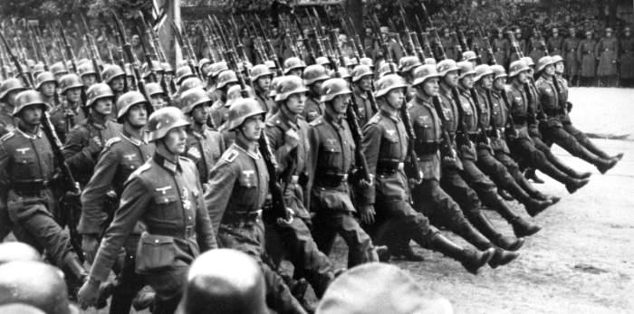 German soldiers march in Warsaw, 1939. The Germany army trialled its 'Blitzkrieg', or 'lightning war' of mechanised land sea and air assaults in Poland. They overran the entire country within days.
