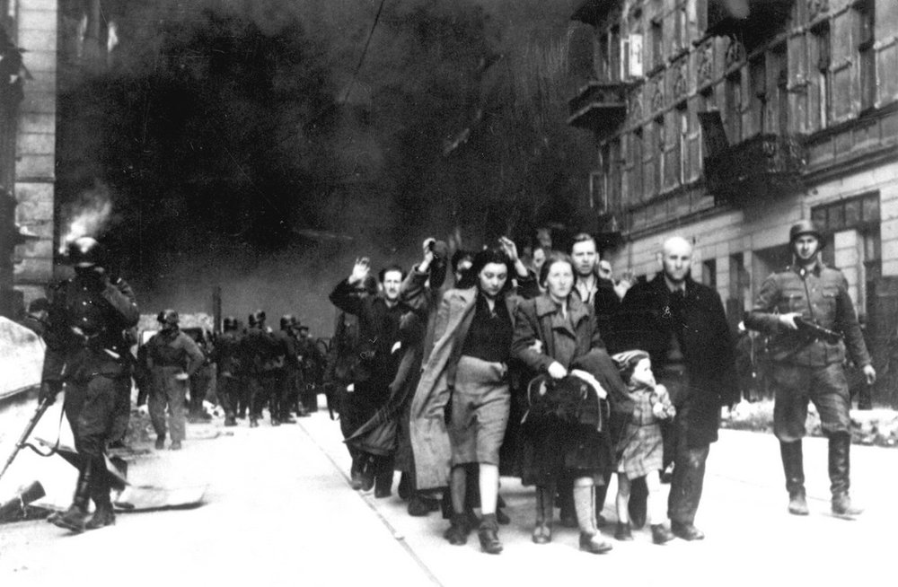 Warsaw Ghetto Uprising April 1943. The revolt of the Jewish Ghetto took more than a month to subdue. In the end the Nazis bombed the Ghetto from the air. Those who were captured were deported to their deaths. The few survivors were those who escaped through the sewers. The Ghetto held out against the German army   for longer than all of Poland.