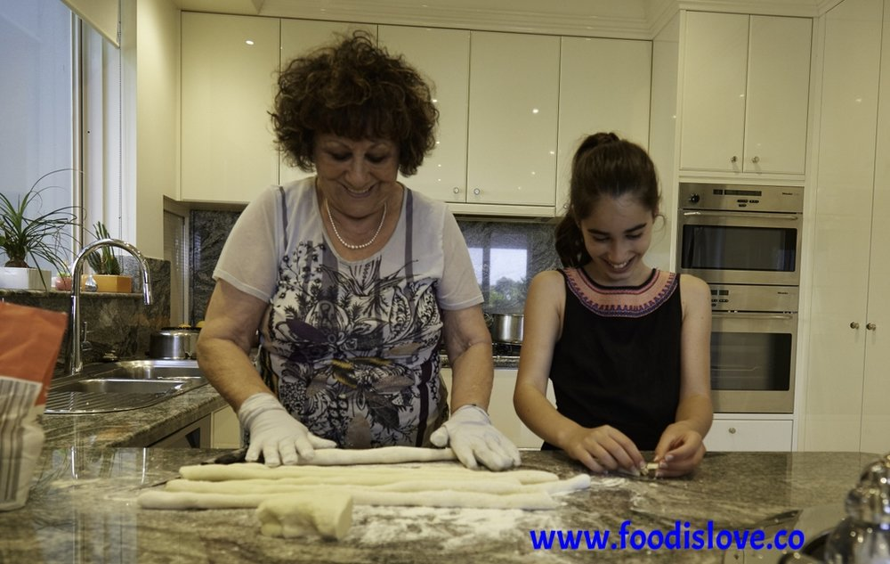 Celina Widawski and her grand-daughter Taya preparing potato gnocchi together in Melbourne, to Celina's mother's recipe.