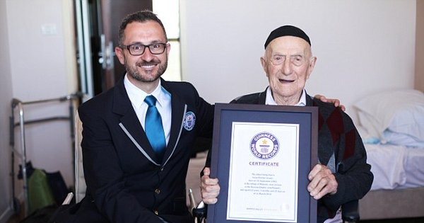 Marco Frigatti and Yisrael Kristal, when he was 'only' 112.   (Dvir Rosen/Guinness World Records/Associated Press)