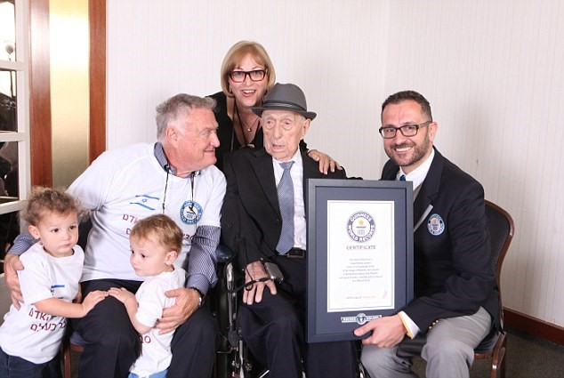Yisrael Kristal with Marco Frigatti from the Guinness Book of Records, son Chaim Kristal daughter Shulamit Kuperstoch and 2 of his great grandchildren. March 2016    (Dvir Rosen/Guinness World Records/Associated Press)
